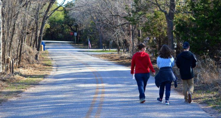 a family walks through Abilene State Park in early spring
